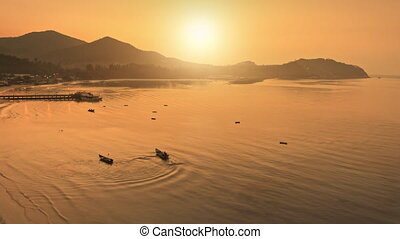 Orange sunset over island sea bay aerial view. Beautiful calm place to stay. Water boat taxi driving