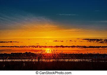 orange sunset over river
