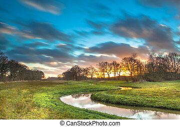 Orange Sunset over River Valley