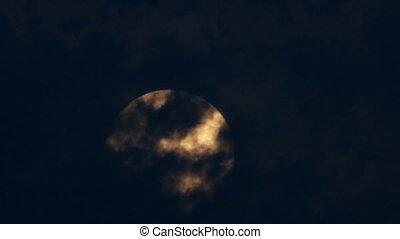 Orange Supermoon in a Cloudy Night - Orange full super moon...