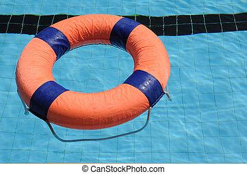 Orange swim ring with deep blue trim floating on water.