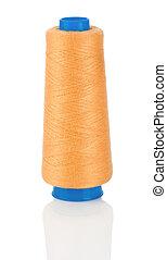 orange thread on blue Spool