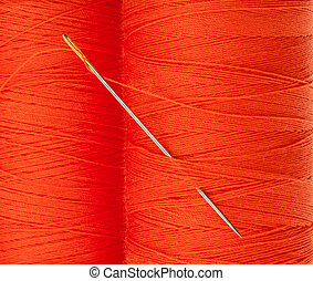 Orange thread with needle background