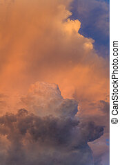 Orange thundercloud in the rays of a beautiful sunset