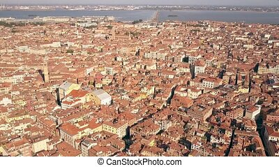 Orange tiled roofs of old buildings in Venice, Italy. Aerial shot