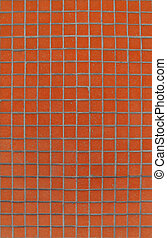 orange tiles mosaic pattern on a wall