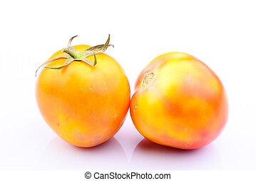 Orange tomatos on white background