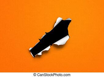 Orange torn paper with black hole