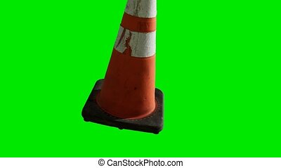 orange traffic cone placed at green chromakey background