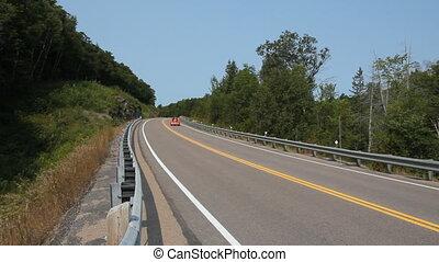 Orange Trike. - Orange Trike passes on Rural highway in...
