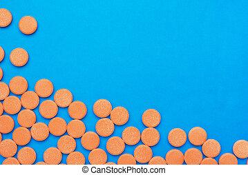 orange vitamin pills