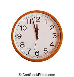 orange wall clock isolated in twelve o'clock.