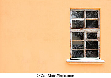 Orange wall with one old window