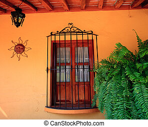 Orange wall with wooden window