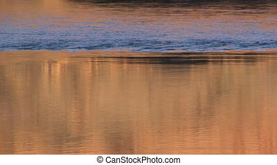 orange water at sunset on the Colorado River