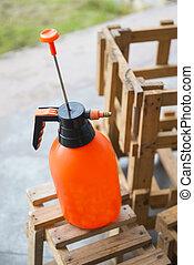 orange water spraying bottle