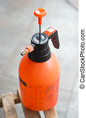orange water spraying bottle