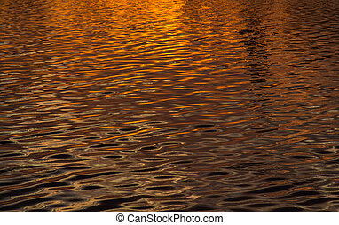 Orange water surface and sun light