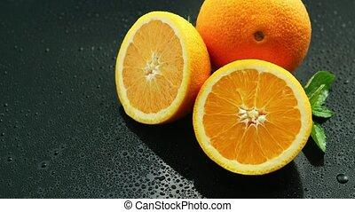 Orange with leaf on wet table