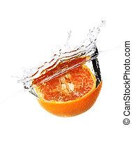 orange with water splash on white