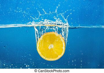 Orange with water splash