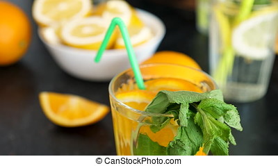 Orangeade water drink with mint. Close up topview dolly...