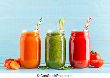 Orange/green/red colored smoothies / juice in a jar