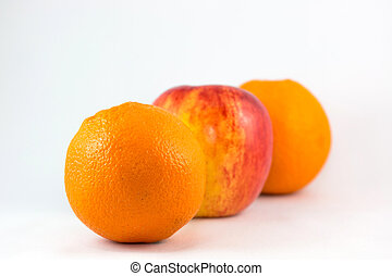 Oranges and apples in row