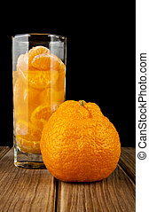 oranges and juice in glass