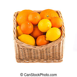 Oranges and lemons in a wooden basket, isolated on white background.