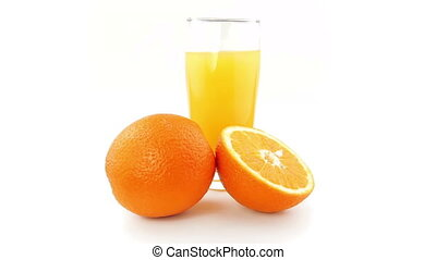 Oranges and orange juice Rotating on a white background