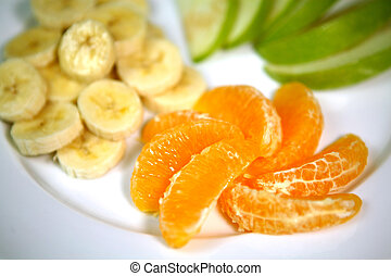 Oranges Bananas and Apples Prepared on a Plate