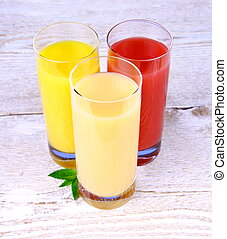 Oranges, bananas and grapefruit juice in glass