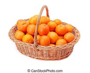 Oranges in basket - Pipe oranges in wicker basket. Citrus ...