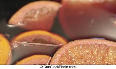 Oranges in Mulled Wine - Orange slices floating on mulled...