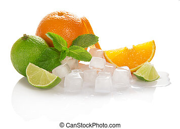 Oranges, limes and mint with cubes of ice