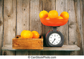 Oranges on scales and in box
