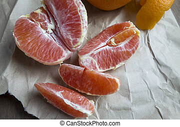 Oranges Sections - Orange sections sitting on crumbled paper...