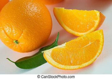 Oranges - Two slices of fresh orange and whole orange with...