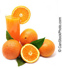 Oranges with green leaves and glass of juice on a white ...