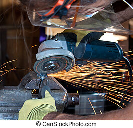 Orbital Grinding - Worker grinding a bolt