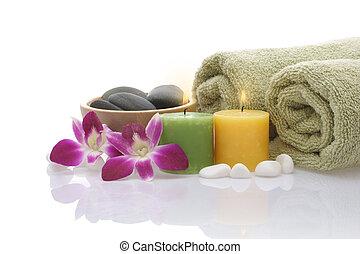 orchidée, cailloux, serviette, arrière-plan vert, bougies, blanc