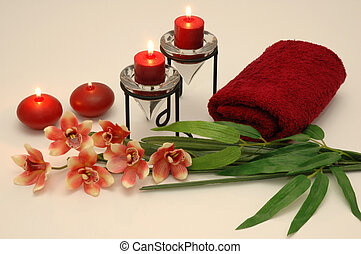 Orchid, towel, and candles