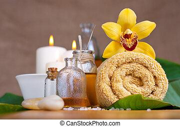 Orchid flower, towel, aroma oils, zen stones