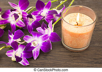 Orchid flowers and candle - Purple orchid flowers and glass...