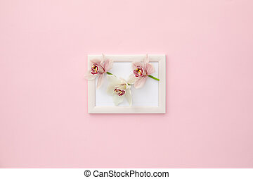 orchid flowers on photo frame