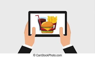 order food online - hand holding device with hamburger...