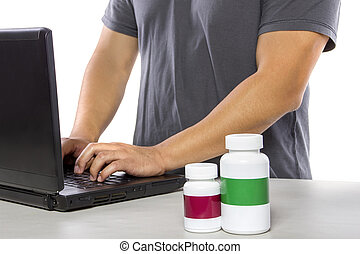 Ordering Supplements at an Online Pharmacy - Man ordering...