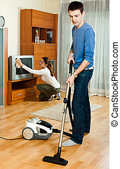 Ordinary family are doing house cleaning