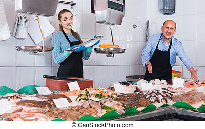 Ordinary fish and seafood store with two sellers - Ordinary ...